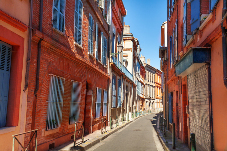 Brick houses on narrow street of Toulouse France