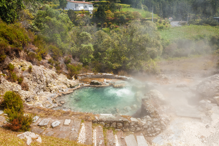 One of the many geysers hot springs and fumaroles scattered in the center of the village of Furnas Sao Miguel Island Azores